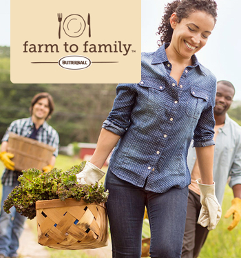 Smiling farmers with Farm To Family Logo