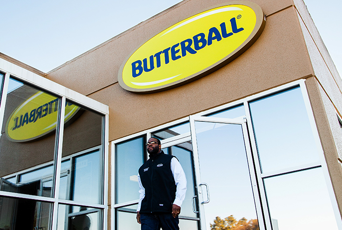 An employee walking out of the butterball building